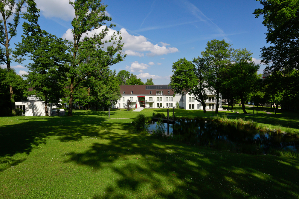 Conference hotel in Bad Aibling Bavaria with a green park